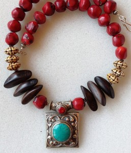 An eclectic Tibetan necklace showcases turquoise, coral and silver from designer Adrienne Lee of Pasadena. (Courtesy of Color Conscious: Diversity in Design)