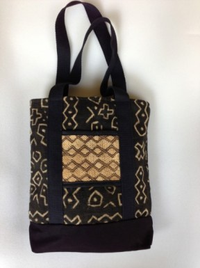 Be noticed toting this bag made from African mudcloth and pocket accent of Kuba cloth. (Courtesy of Color Conscious: Diversity in Design)