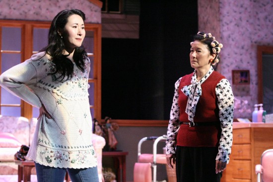 """Shelby (Ruth Coughlin) breaks the news that she is pregnant to her mother, M'Lynn (Patti Yasutake), in a scene from """"Steel Magnolias."""" (Photo by Michael Lamont)"""