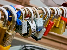 Hundreds of lovers' padlocks are clipped on railings.