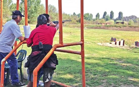 Ken Hashizume (holding shotgun) won a gold medal in his first experience shooting as a beginner. (Photos courtesy Lynn Wadahara)