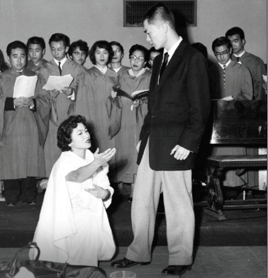 """Mary (Tagumi) Bushman and George Takei, as the Buddha, perform a scene in Hiroshi Kashiwagi's play """"Kisa Gotami"""" at the Berkeley Buddhist Temple in 1956. Takei was a UC Berkeley student at the time and later transferred to UCLA to study acting. (Photo by Isao Isago Tanaka)"""