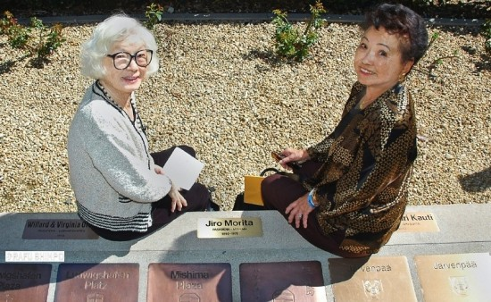 Sisters Elsie Osajima (left) and Helen Matsunaga sit beside a plaque dedicated to their father, Jiro Morita, who helped to establish the sister-city relationship between Pasadena and Mishima. Morita was one of five pioneering members of the Pasadena Sister Cities Committee honored on March 8. (MIKEY HIRANO CULROSS/Rafu Shimpo)