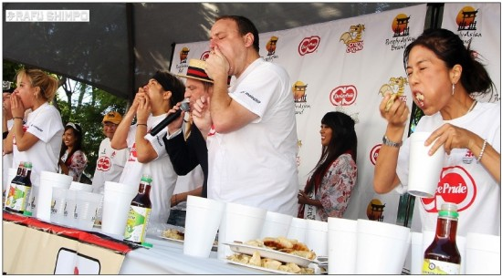 """Joey Chestnut and Matt """"the Megatoad"""" Stonie compete in the 2013 Day-Lee Foods World Gyoza Eating Championship. (MARIO G. REYES/Rafu Shimpo)"""