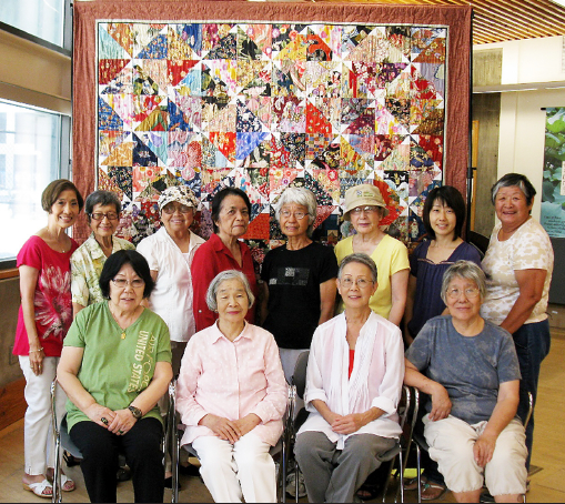 """Little Tokyo Library Quilters with this year's raffle quilt, """"Pinwheels."""" (Photo by Pedro Trujillo)"""