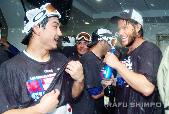 Dodger infielder Darwin Barney and pitching ace Clayton Kershaw enjoy the moment, as the team celebrates clinching the National League West pennant on Wednesday. (Photos by MIKEY HIRANO CULROSS/Rafu Shimpo)