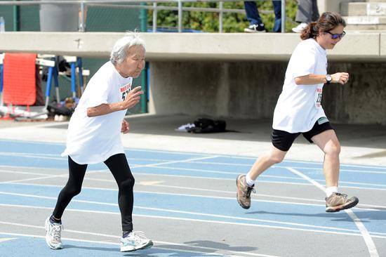 Octogenarian Sumi Onodera-Leonard, left, and Sandra Nitta compete in the women's 100-meter dash.