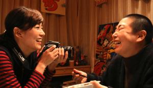 "Asami Mizukawa and Miyuki Oshima (playing a man) in ""Fuku-chan of Fukfuku Flats."""