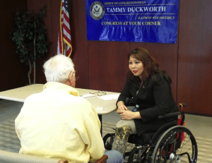 """Rep. Tammy Duckworth talks to a constituent at a recent """"Congress at Your Corner"""" event."""