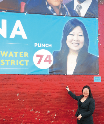 Josina Morita points to one of her campaign posters in Chicago.