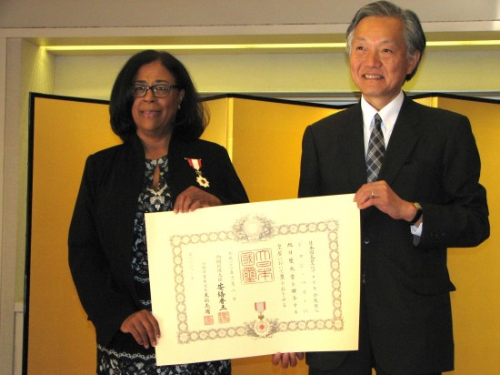 Consul General Harry Horinouchi presented Jan Perry with a medal and a proclamation with the emperor's seal and Prime Minister Shinzo Abe's signature.