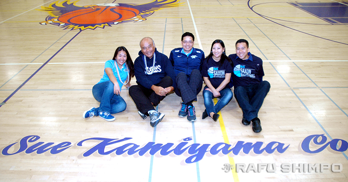 Seated on the basketball court named for their late matriarch, the Kamiyama family – from left, Lauren, Ed, Darin, Lori and Stephen – gathered at Bell High School on Dec. 19 for the game against Lauren's North High girls. The evening was as much about community as it was about sport. (Photos by MIKEY HIRANO CULROSS/Rafu Shimpo)