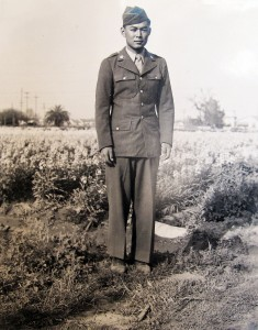 Tomio Muranaka poses in uniform amid the flowers at the family farm in Paramount in 1946. He had been given emergency leave from the Army when his father had taken ill.