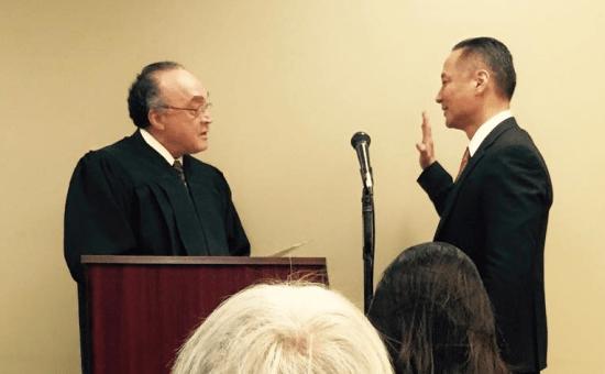 Public Defender Jeff Adachi is sworn in by Judge Donald Mitchell.