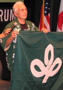 Yoshihito Yonezawa of Miyagi Kenjinkai holds up the flag of Miyagi Prefecture.