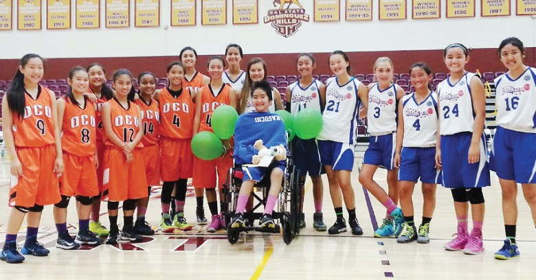 : Sakaguchi is honored at center court by her teammates from Kool Kats and OCO Heat on Oct. 6, 2014 at Cal State Dominguez Hills.