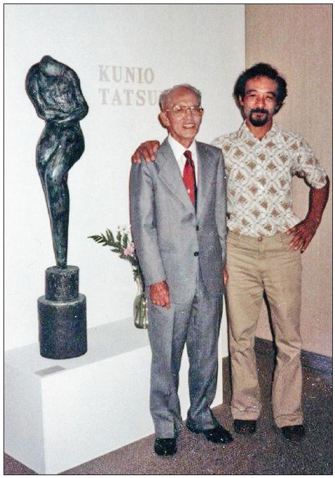 Kunio Tatsui poses at the JACCC Doizaki Gallery with artist Kenzi Shiokava.