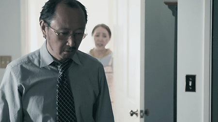 """Isamu's frustrated father and concerned grandmother in a scene from """"American Hikikomori."""" (Photo courtesy of Landis Stokes)"""