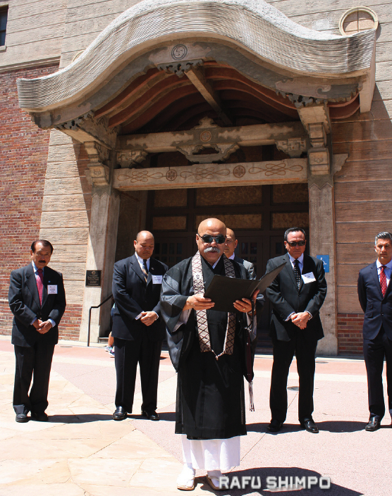 Rev. William Briones of Nishi Hongwanji Buddhist Temple offers a blessing for the new center.