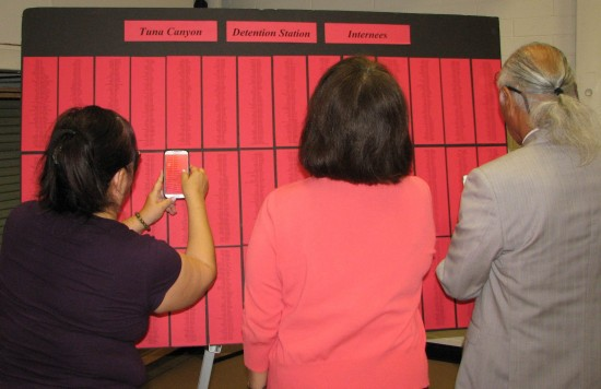 Attendees looked for names of family members on a list of internees at Tuna Canyon Detention Station.