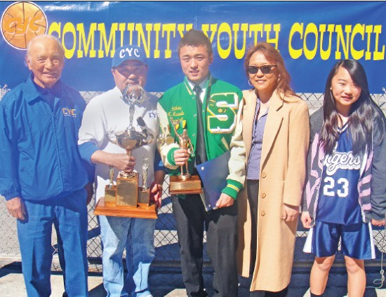 In 2011, Tom Kawada, second from left, received the Kohashi/Taniguchi Award during the annual CYC Jamboree. He is pictured with CYC Trustee Joe Yamagawa (left), son Kenny, wife Nancy, and daughter Kaylin.