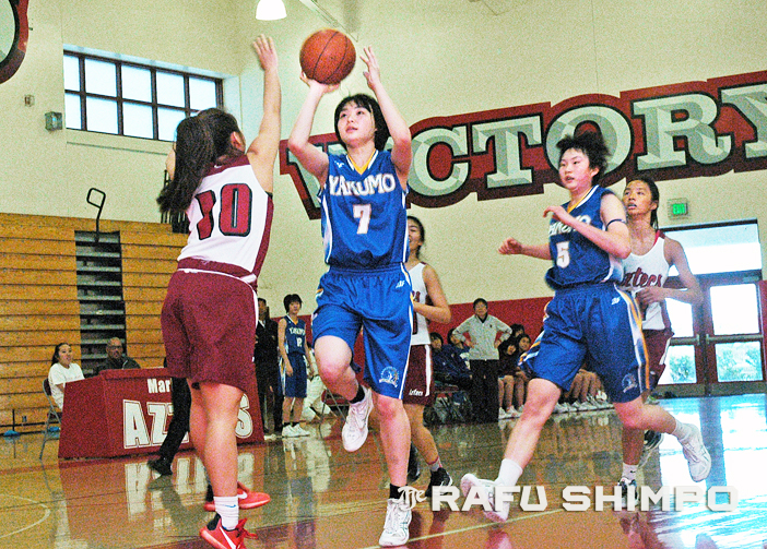 Yakumo Academy's Mai Yoshida shoots over Sydne Kaku for two of her seven points, during an exhibition game against the Lady Aztecs of Mark Keppel High, Monday in Alhambra. The Tokyo city champions have been in Southern California for a training camp and three friendly matches. (Photos by MIKEY HIRANO CULROSS/Rafu Shimpo)