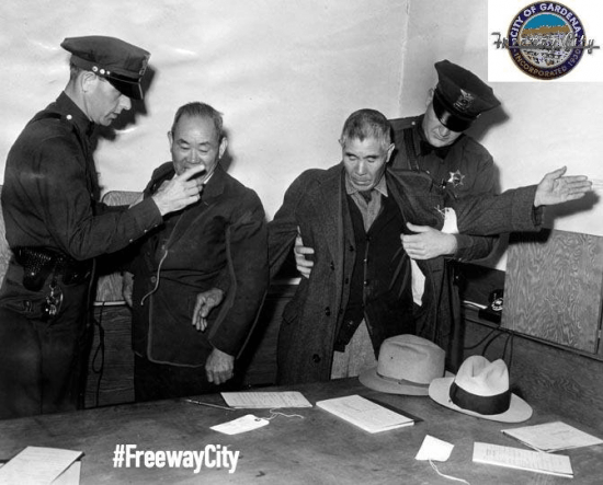 """Two Japanese American residents of Gardena being taken into custody in a giant roundup staged by federal agents after Pearl Harbor. (From """"Freeway City"""")"""