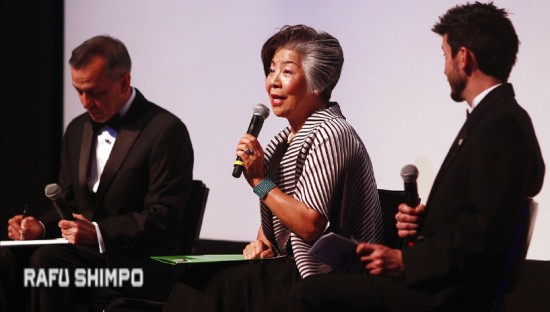 Masako Unoura-Tanaka, who survived the tsunami, is interviewed by Austin Augur II (right) with his father, Austin Augur I, serving as interpreter.