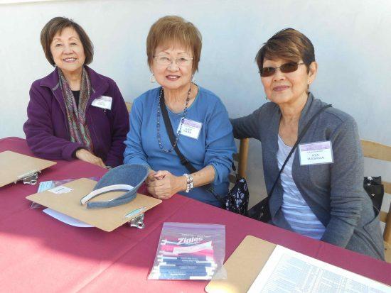 Volunteers June Tomita, Judy Nawa and Aya Masada.