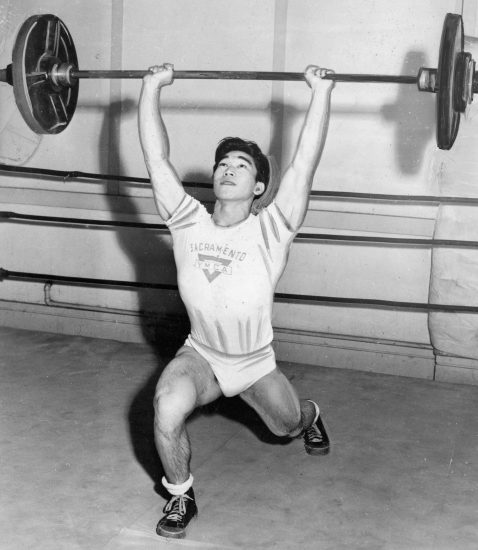 A young Tommy Kono lifts during a competition at the Sacramento YMCA. (Courtesy Center for Sacramento History, Sacramento Bee Archive)