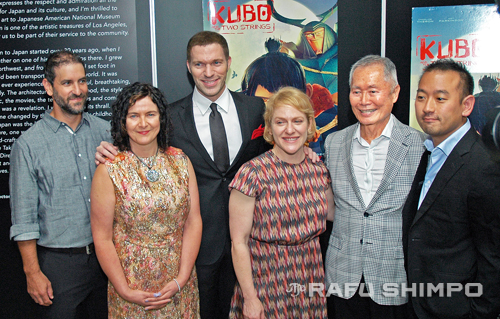 """Cast and crew of """"Kubo and the Two Strings"""" assembled last Thursday at the Japanese American National Museum, as actor George Takei donated a figure of the character he voiced in the film to the museum. From left, animation supervisor Brad Schiff, costume designer Deborah Cook, director Travis Knight, producer Arianne Sutner, Takei, and Japanese consultant Taro Goto. (MIKEY HIRANO CULROSS/Rafu Shimpo)"""