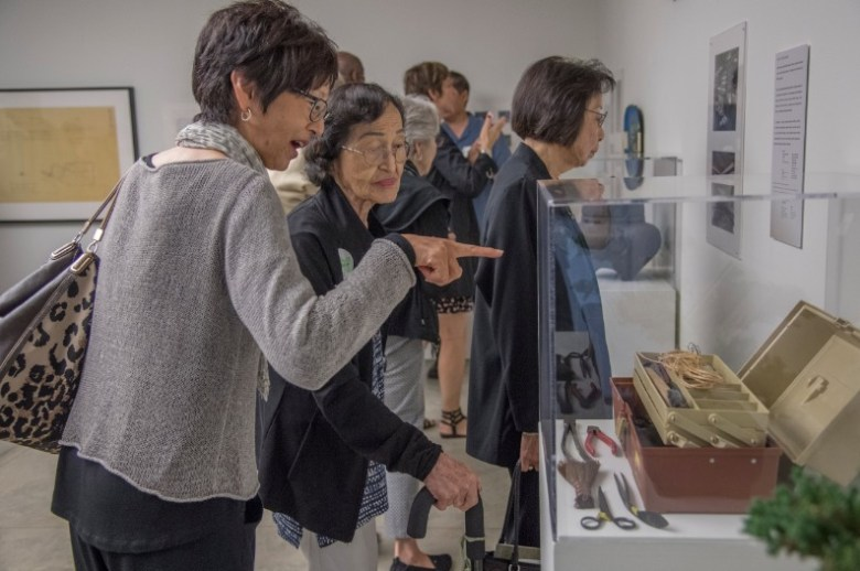"""Guests enjoy the artifacts on display at the """"Sharing Culture 