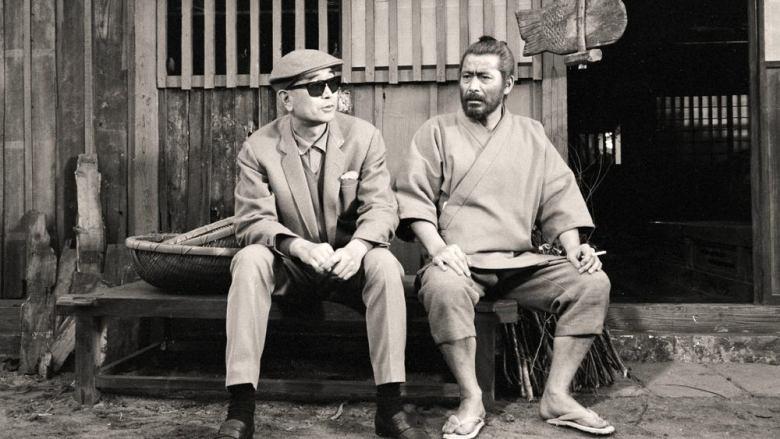 "Toshiro Mifune and director Akira Kurosawa on the set of ""Red Beard"" (1965)."