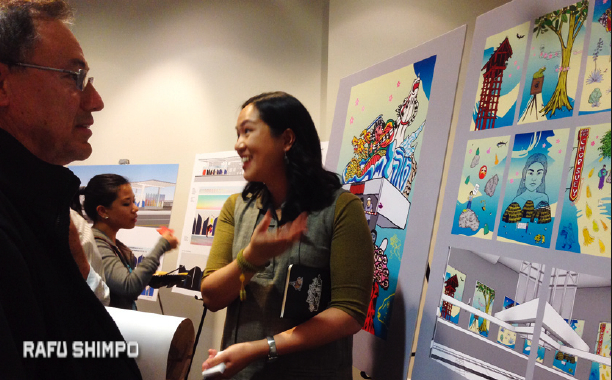 Little Tokyo resident George Campos, left, listens as artist Audrey Chan describes her concepts.