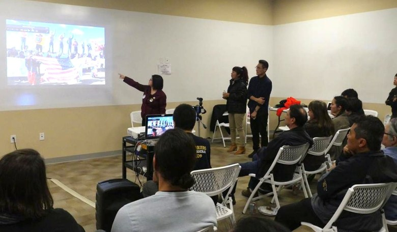 Water protector R.G. Wong (left), who went twice to Standing Rock, narrates a slide show showing the struggle. She is joined by fellow water protector Nancy Kim (center) and David Monkawa (right), who helped organize the fundraiser.