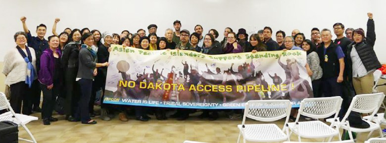 Asian Pacific Islander nonprofits raise funds and sign a banner for NoDAPL on Dec. 11 in Los Angeles.