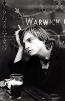 Mark Smith of The Fall --- Image by S.I.N./CORBIS 1 Adults Alcoholic beverage Bar Beer glass Beers Beverage British Cigarette Containing English English text Europeans Furniture Males Mark Smith Men Music Musician Pensive People Prominent persons Rock music Singers Smoking Table Text The Fall Whites Young adults
