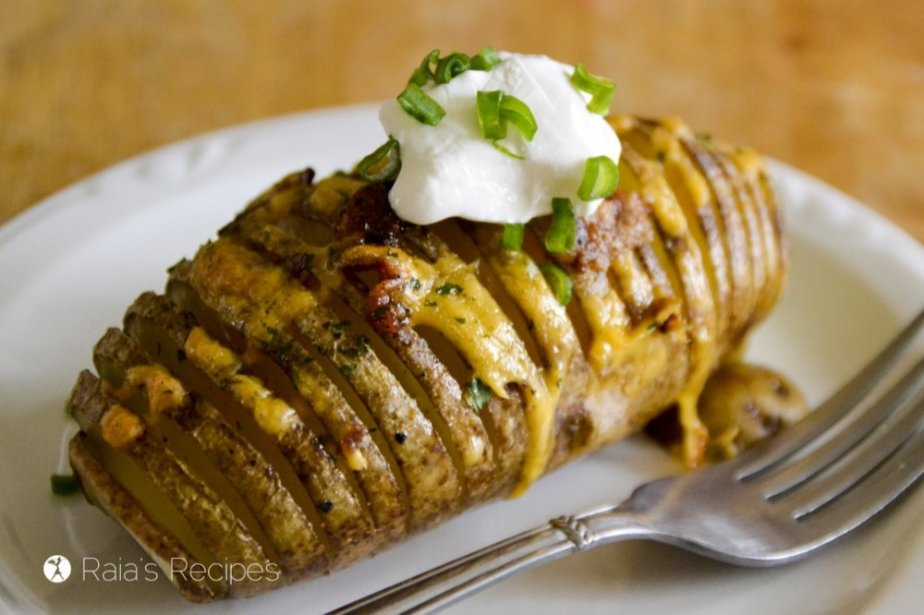 Perfectly baked and stuffed with all your favorite toppings, these Loaded Hasselback Potatoes are sure to become a favorite! RaiasRecipes.com