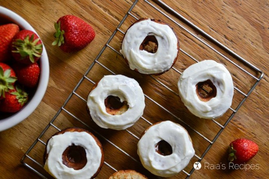 Need a delicious treat that shouts summer fun, but is still healthy? These grain-free, and refined sugar-free Strawberry Banana Donuts with Honey Cream Cheese Frosting are just the thing.   RaiasRecipes.com