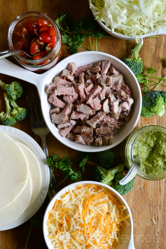 Tender Grilled Tenderloin Tacos with Broccoli Chimichurri Sauce piled onto a raw jicama taco shell and topped with Sargento Chef Blends 4 State Cheddar Cheese. The perfect gluten-free taco! RaiasRecipes.com