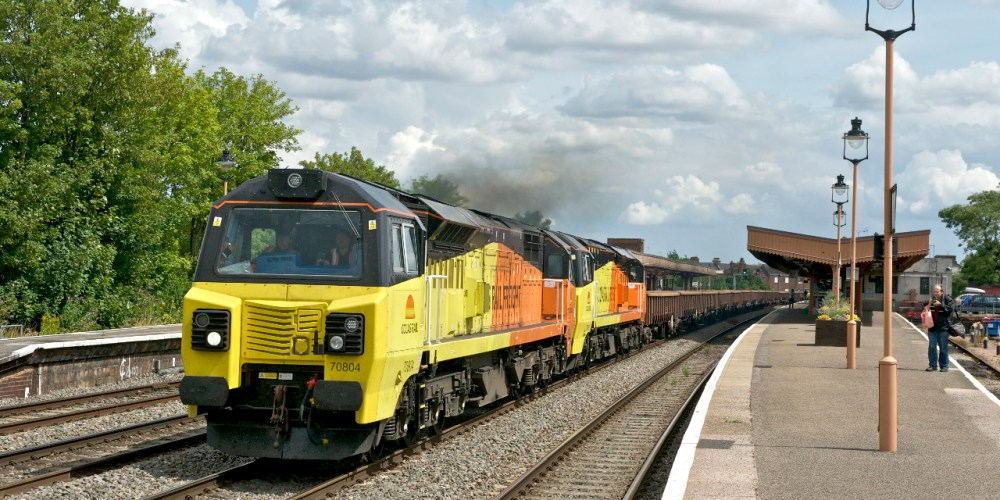 Colas Rail 70804 and 70805 head through Leamington Spa Station on August 4, 2014. Photo: Peter Lovell
