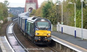 Diverted 4D47 Inverness-Mossend Yard 'Tesco' intermodal, passing Dalmeny, hauled by 68022 'Resolution' on 23-10-2016