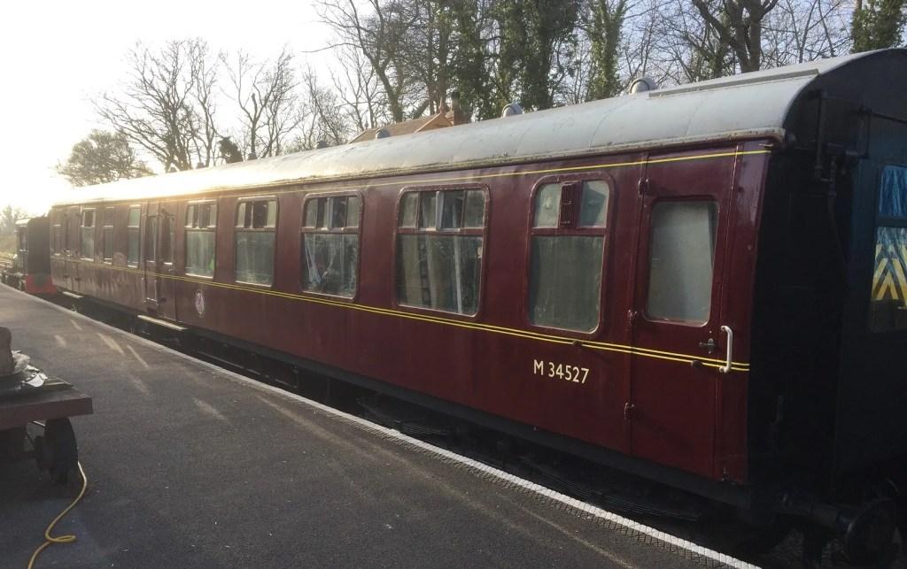 M34527 mark 1 railway carriage in the platform at Midsomer Norton