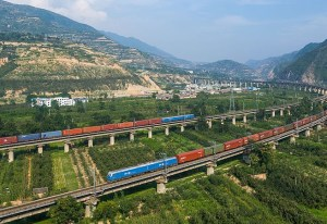 Two China Railways freight trains meet on the Longhai line near Yuanlong, between Tianshui and Baoji, China. Both trains are hauled by HXD1 locomotives