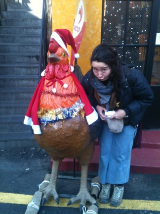 Making silly faces in front of a fried chicken eatery.