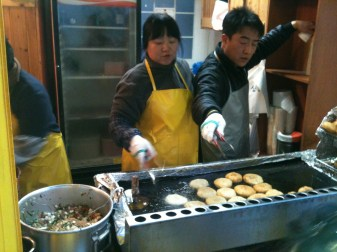 deep fried heartily crunchy sweet cakes. Sometimes filled with gelatinous noodles and ground beef. Oozed deliciousness