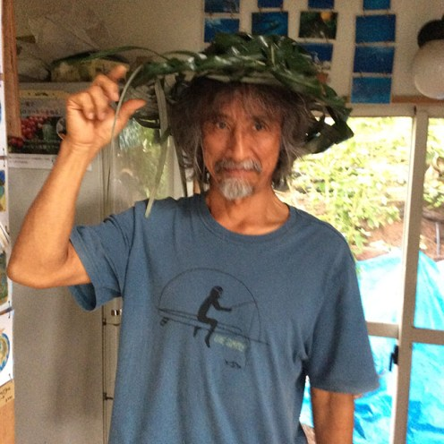 Ryo makes silly faces for the camera while he models his new handmade palm-leaf hat.