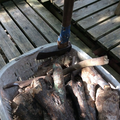Chopping wood for the wood-fire powered bath and the daily bread baking/rice making.
