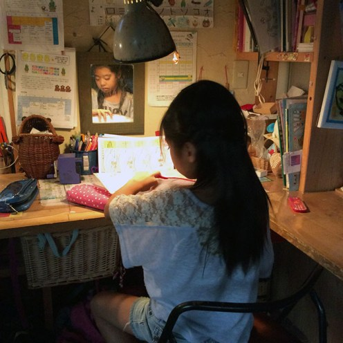 Umi-chan does her homework after dinner.