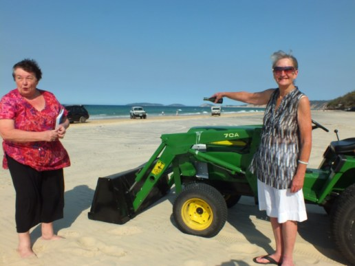 Sandy christens the tractor